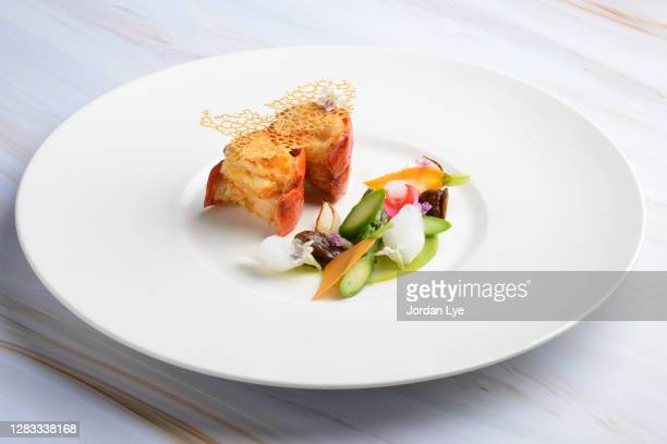 lobster, garnished with chestnut confit and seasonal vegetables - gourmet stock pictures, royalty-free photos & images