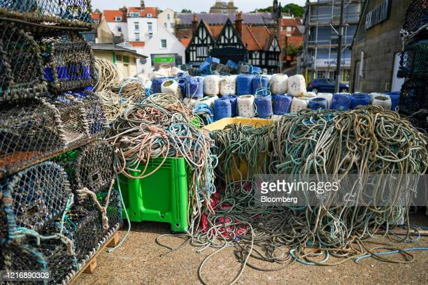 Lobster pots and rope are stored on the quayside in the harbour in Scarborough UK on Tuesday June 2 2020 The threat of a nodeal Brexit is back and...