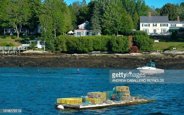 Lobster pots are seen moored near houses in Boothbay Harbor Maine on August 10 2018