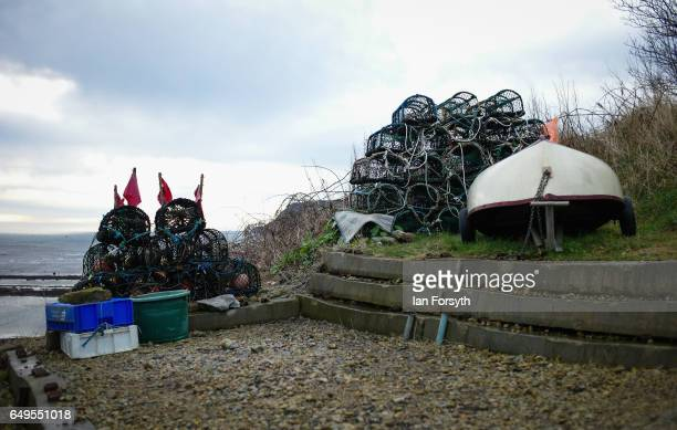 Lobster pots are stacked in Robin Hood's Bay on the North Yorkshire coast on March 8 2017 in Robin Hood's Bay United Kingdom Robin Hood's Bay is a...