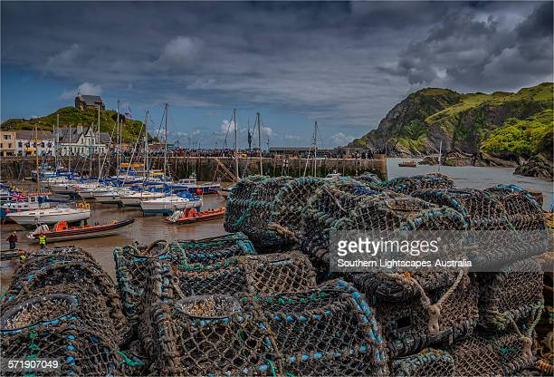 lobster pots at ilfracombe - ilfracombe stock photos and pictures