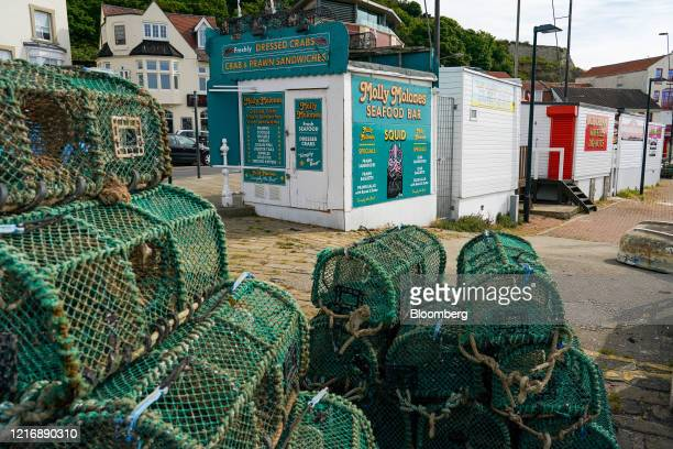 Lobster pots sit stacked on the quayside in the harbour in Scarborough UK on Tuesday June 2 2020 The threat of a nodeal Brexit is back and with it...