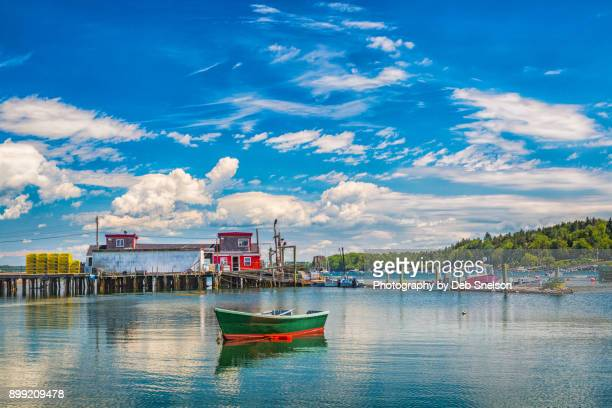 lobster pound and rowboat bailey's island maine - portland maine stock photos and pictures