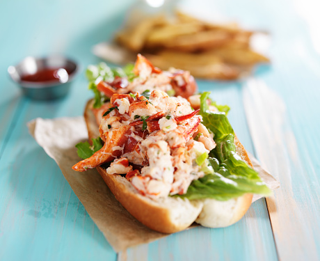 lobster roll on colorful retro painted wooden planks 487499608