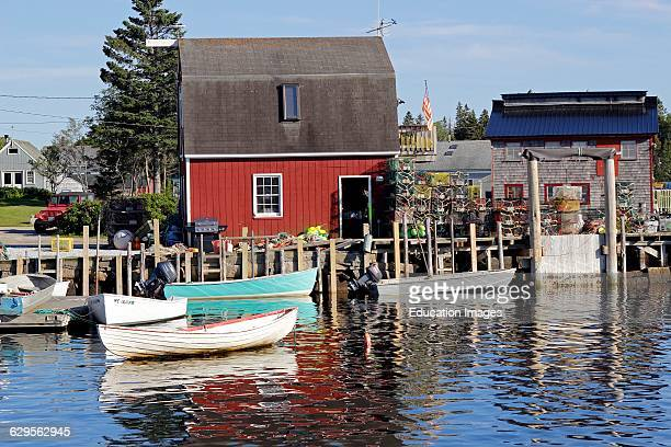 Lobster shack with small boats on waterfront Vinalhaven Island Maine New England USA