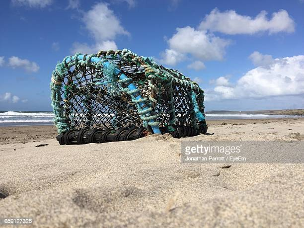 Lobster Trap On Sandy Beach During Sunny Day