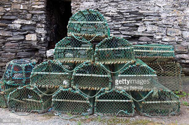 lobster trap slade harbour county wexford ireland - crab pot stock photos and pictures