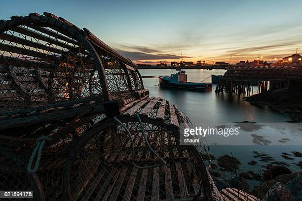 lobster traps in twilight - fishing industry stock pictures, royalty-free photos & images