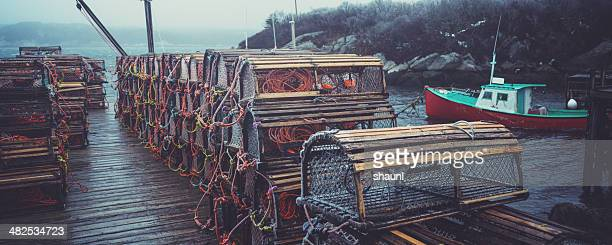 lobster traps on wharf - north america stock pictures, royalty-free photos & images
