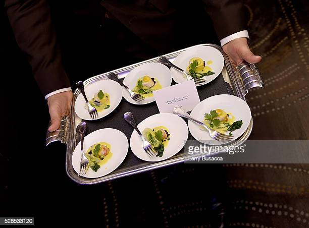 Lobster with Curried Coconut Black Rice and Bok Choy is served to guests at Saveur and AirFrance Celebrate Saveur's France Issue at Daniel on May 5...
