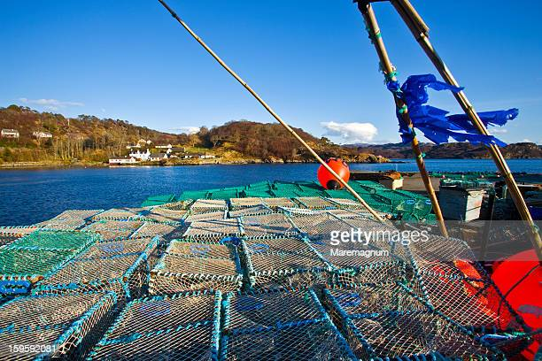 Gairloch stock photos and pictures getty images lobsters cages on the loch gairloch malvernweather Choice Image