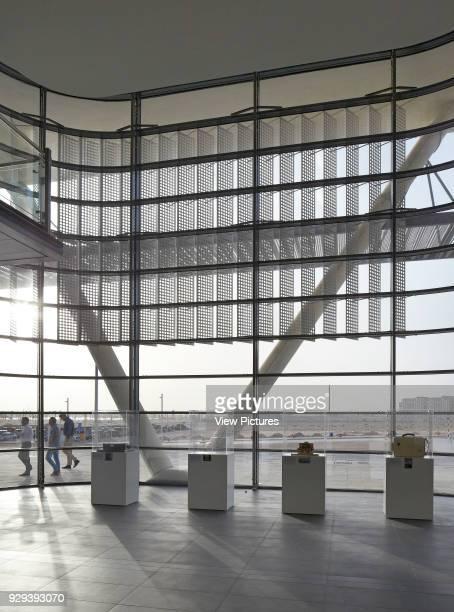 Loby view through with exterior sun shading system. Siemens Masdar, Abu Dhabi, United Arab Emirates. Architect: Sheppard Robson, 2014.