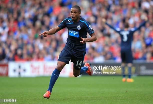 Loïc Rémy of Newcastle United celebrates after scoring a goal during the Barclays Premier League match between Cardiff City and Newcastle United at...