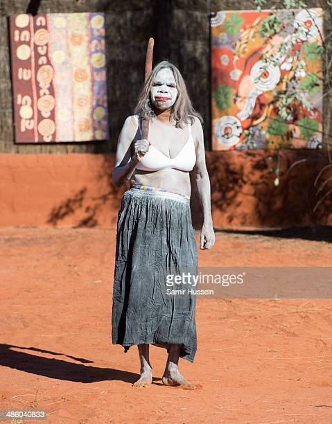 A local Aboriginal woman performs for Catherine Duchess of Cambridge and Prince William Duke of Cambridge at a local cultural centre at Uluru on...
