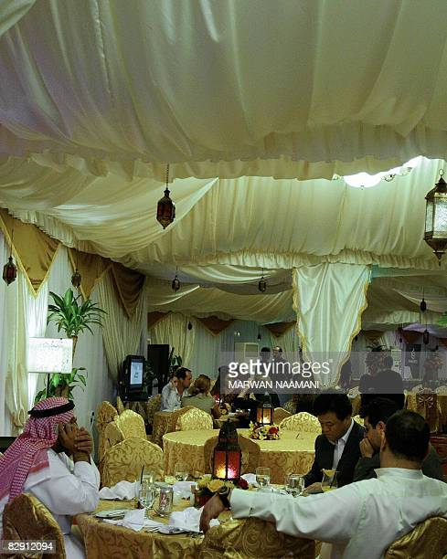 Local and foreign clients break their fast in the Ramadan tent of a fivestar hotel in Dubai on September 16 2008 Besides charity banquets for the...