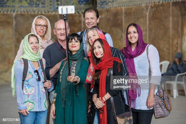 local and foreign tourists take a selfie, shah mosque, isfahan - iranian culture stock photos and pictures