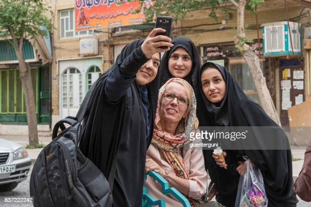 Local and foreign women taking a selfie, Yazd, Iran