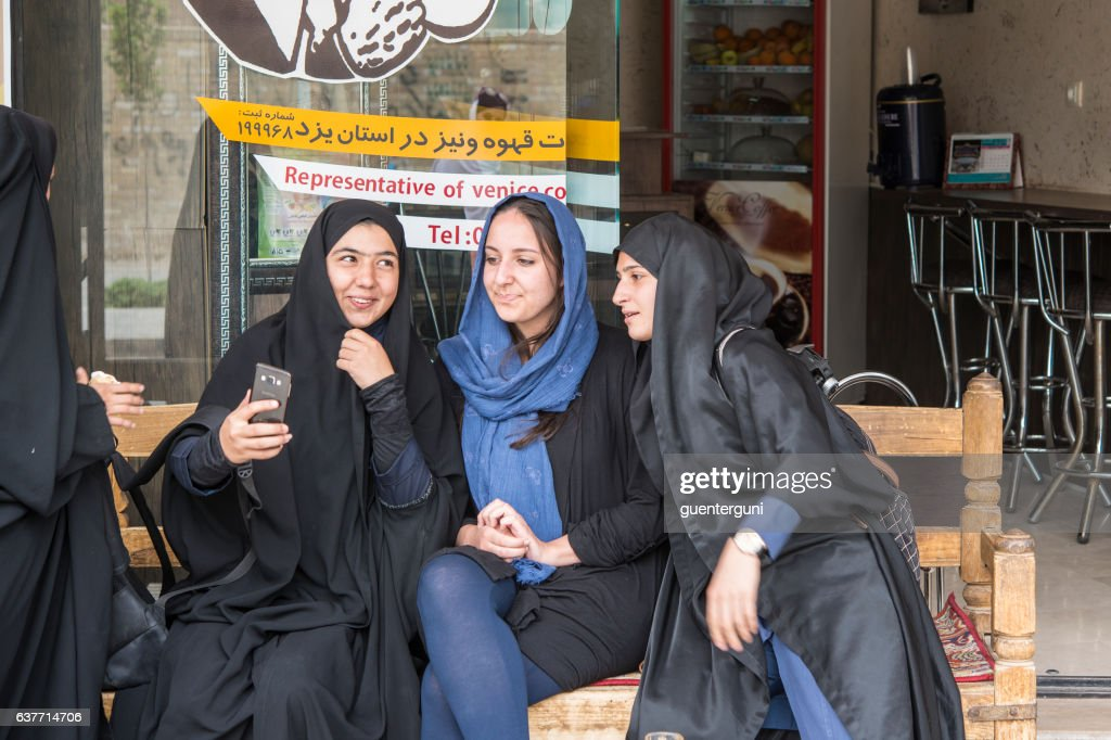 Local and foreign women taking a selfie, Yazd, Iran : Stock Photo
