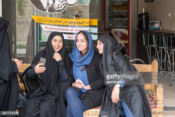 local and foreign women taking a selfie, yazd, iran - iranian woman stock photos and pictures