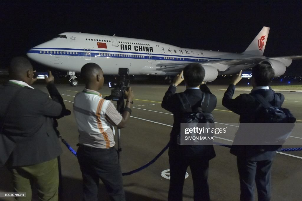 Local and international journalist film the plane carrying China president and his wife upon their arrival in Kigali July 22, 2018 for a two day state visit in Rwanda. - Jinpings visit aims to further strengthen diplomatic ties and cooperation between the two countries.