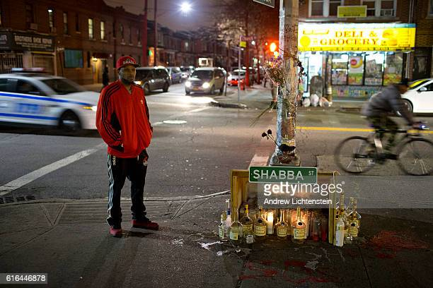 Local antiviolence activist and former Bloods gang member Shanduke McPhatter stands next to a street memorial on Church Avenue for Darnell Faustin in...
