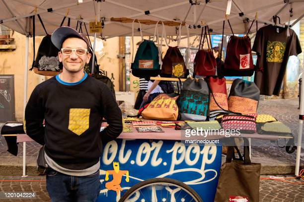 "local artist working in small outdoors market in bologna, italy. - ""martine doucet"" or martinedoucet stock pictures, royalty-free photos & images"
