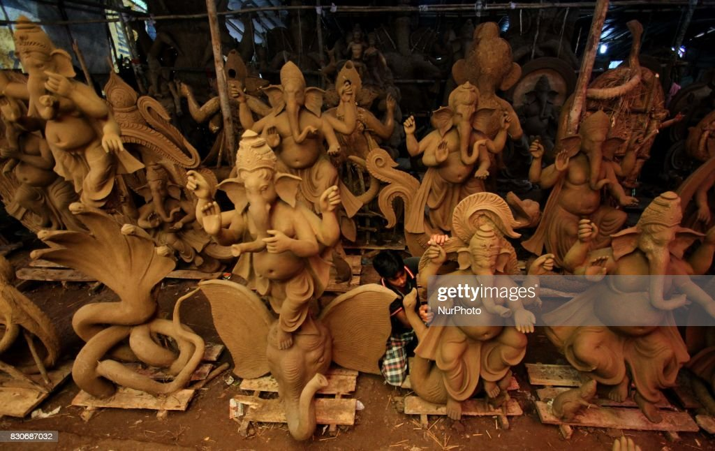 Local artists busy to built clay idols of elephant headed God Ganesha at a workshop ahead of the Ganesha Chatruthi festival in the eastern Indian state Odisha's capital city Bhubaneswar on 12 August 2017.