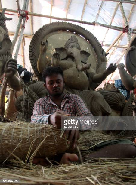 Local artists busy to built clay idols of elephant headed God Ganesha at a workshop ahead of the Ganesha Chatruthi festival in the eastern Indian...