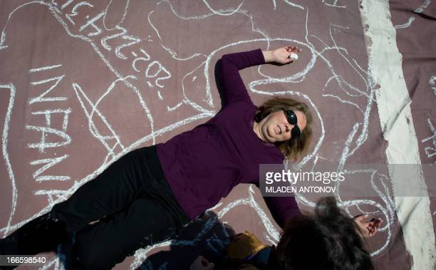 Local artists trace an outline of their bodies with chalk to represent persons killed by guns at the Lincoln Memorial reflecting pool as they take...