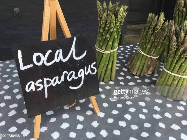 Local asparagus sign and asparagus bundles