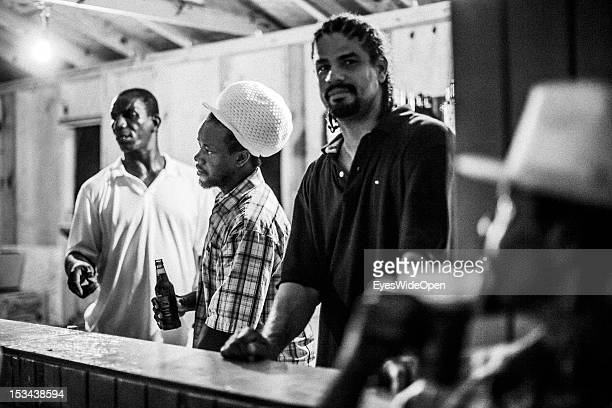 Local bahamian young men with rasta dreadlocks hair are selling drinks and beer at the annual Rake 'n' Scrape Festival on June 15 2012 in Cat Island...