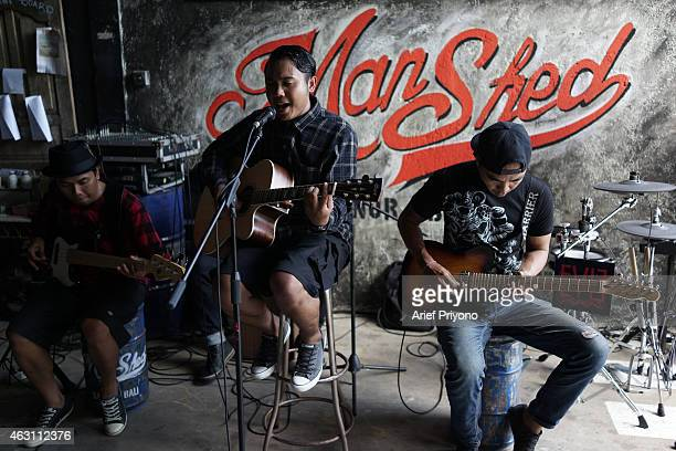 A local band entertain visitors at ManShed Cafe Sanur The ManShed cafe in Sanur Bali is themed on an old style garage and is full of motorcycles and...