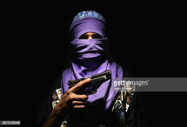 """Local Bario 18 gang leader """"El Mortal"""" poses for a photo on August 19, 2017 in San Pedro Sula, Honduras. He said he has been a gang member since he..."""
