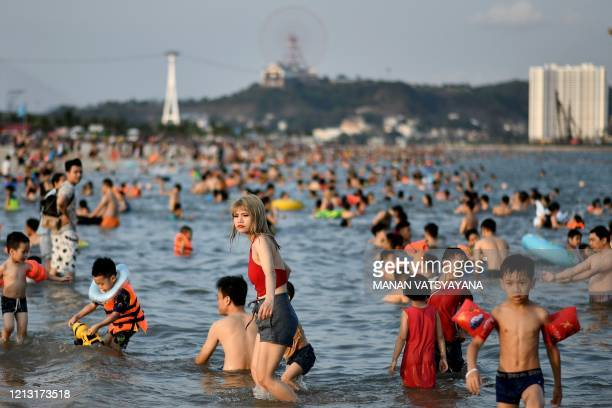 Local beachgoers enjoy a swim at the Bai Chay beach in Ha Long city of northeastern province of Quang Ninh on May 16, 2020.