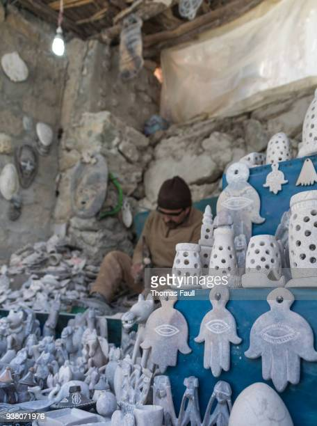 Local Berber man carves Alabaster stone into souvenirs in Ourika Valley, Morocco