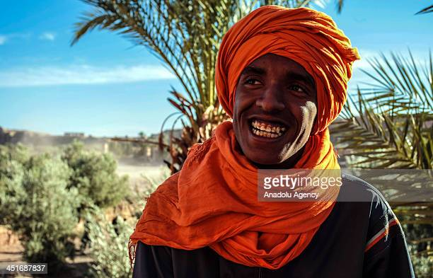 A local Berber poses as he talks about the fortified city of Ait Benhaddou known for its kasbah and for several movies shot in there such as The...