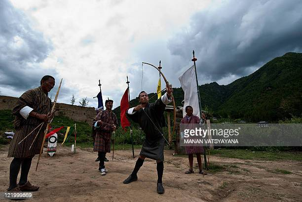 Local Bhutanese villagers take part in a game of archery on a field in Paro on August 21, 2011. Archery, an ancient traditional sport, is Bhutan's...