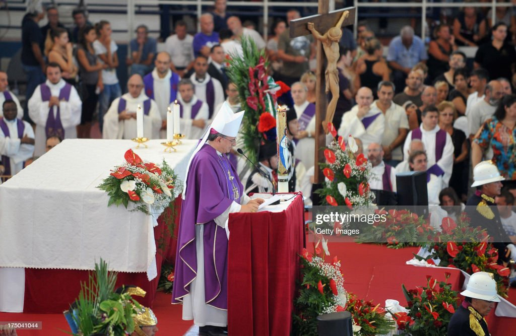Local bishop Gennaro Pascarella speaks during the funeral of the victims of the Monteforte Irpino coach crash held at a local indoor sports arena on July 30, 2013 in Pozzuoli, Italy. In the second major European transport disaster in a week, 39 people were killed when a coach bus fell from a viaduct near Monteforte Irpino, Italy on July 28.