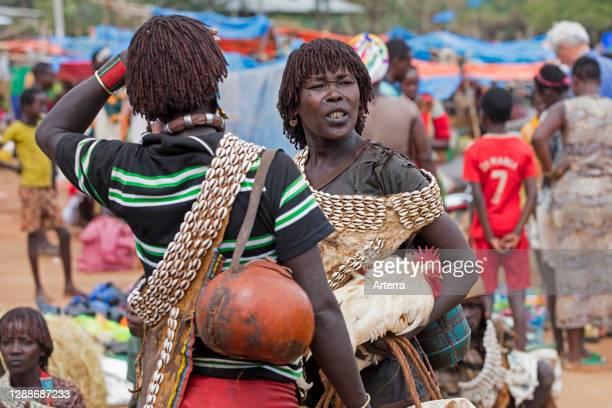 Local black women of the Banna / Banya tribe at the Key Afer / Key Afar market, Lower Omo Valley, Debub Omo Zone, Southern Ethiopia, Africa.