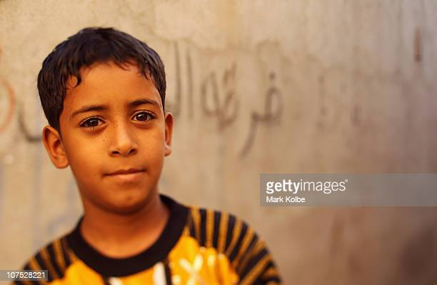 A local boy is seen in an alley at the Al Dhalam Souk at Muttrah corniche on December 9 2010 in Muscat Oman