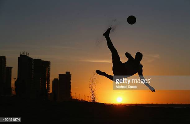 A local boy shows off his beach football skills on Magna Praia beach on June 11 2014 in Fortaleza Brazil