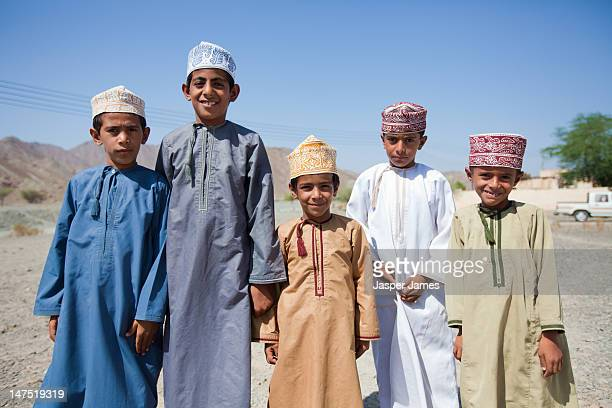 local boys posing for camera,muscat