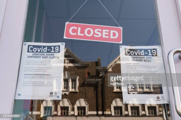 Local branch of Oxfam charity shop remains closed in Earlsfield, south-west London, due to Covid-19 pandemic on 21 May, 2020 in London, England. It...