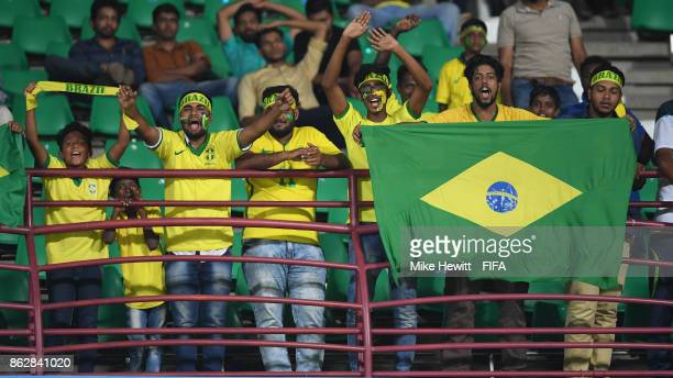 Local Brazil fans celebrate at the end of the FIFA U17 World Cup India 2017 Round of 16 match between Brazil and Honduras at the Jawaharlal Nehru...