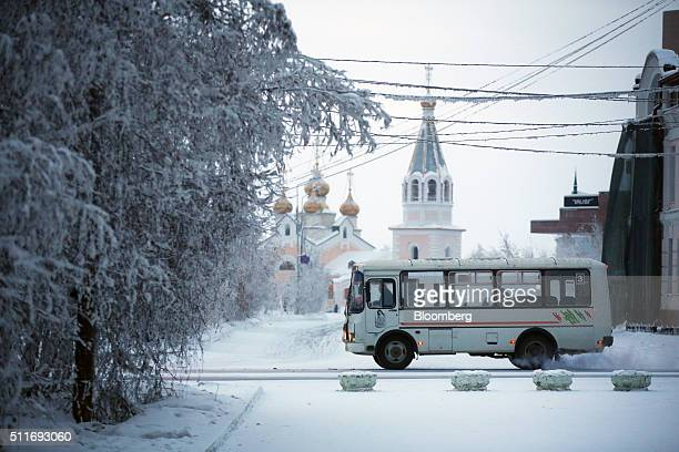 A local bus passes a Russian orthodox church as it drives along a frozen city road in Yakutsk Sakha Republic Russia on Sunday Feb 14 2016 Yakutsk the...