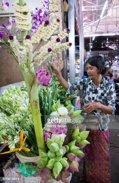 Local Cambodian Woman Selling Local Flowers in Market in Siem Reap Camb.