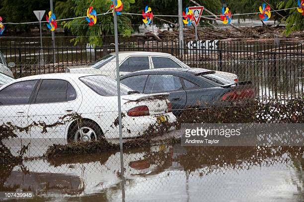 A local car dealer's yard is flooded after heavy rainfall hit the capital region on December 9 2010 in Queanbeyan Australia Many residents have been...