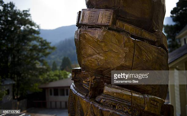 Local carved a train looping its way up the trunk of a tree in Dunsmuir, Calif.