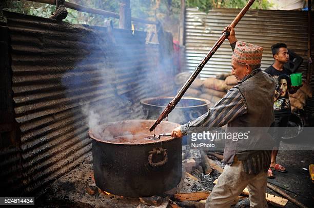 A Local checks Molten Raw Hardened molasses to prepare molasses Chaku on 06 January 2015 at Tokha Kathmandu Nepal for the celebration of Maghe...