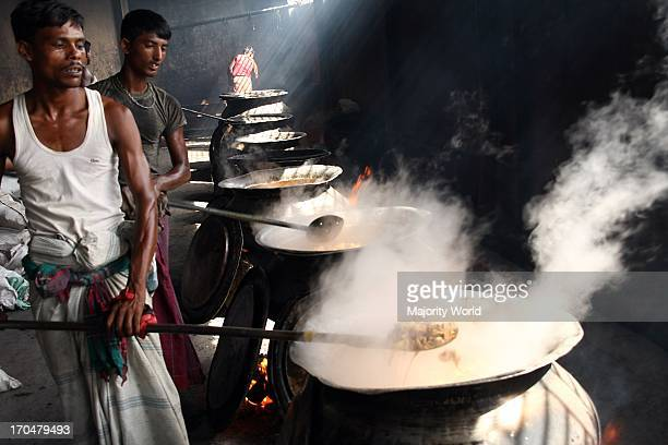 Local chefs cooking beef for a mezban The word mezban in Persian means host In Chittagong mezban stands for community feast with a simple menu of...